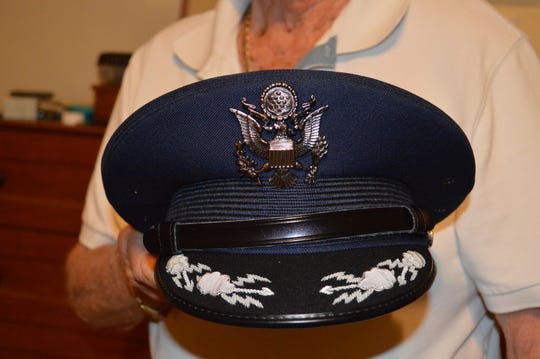Retired Air Force Col. Charlie Luse shows parts of his new uniform, gifted to him by Sen. Martha McSally.