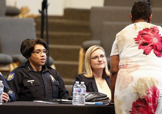 Phoenix Police Chief Jeri Williams and Phoenix Mayor Kate Gallego talk to a woman who approached them before a public meeting on police issues at the Pilgrim Rest Baptist Church in Phoenix, June 18, 2019.