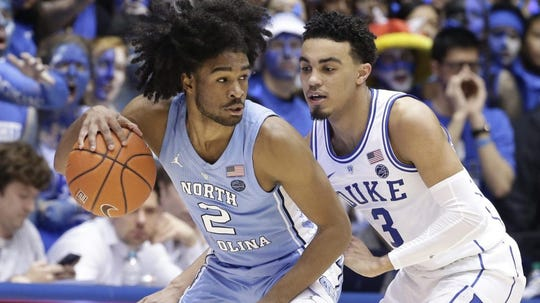 UNC's Coby White dribbles against Duke's Tre Jones during a game this season.