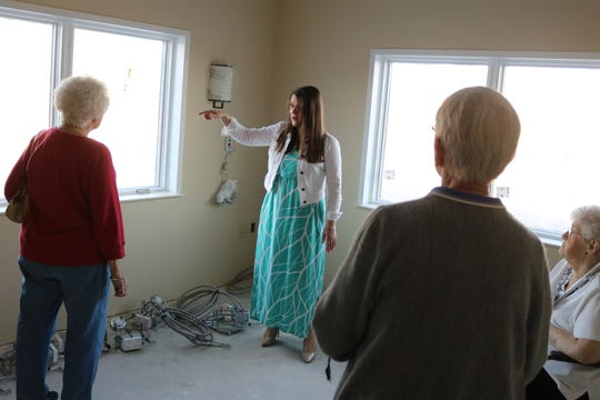 Kendra German, administrator of the Riverview Healthcare Campus, shows some prospective future residents an example of a room under construction that is part of the assisted living expansion.
