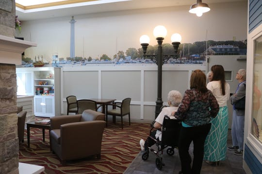 "A few prospective future residents tour the newly renovated ""Towne Square"" area of the Riverview Healthcare Campus, which offers a downtown feel."