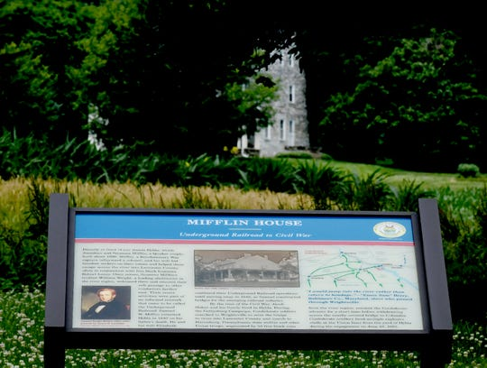 A Civil War Trail sign featuring the Mifflin House, background, sits at the end of the 600 block of Cherry Street in Wrightsville Wednesday, June 19, 2019. Civil War Trails, a history tourism organization with 1,650 trail stops in six states, facilitated the installation. Bill Kalina photo