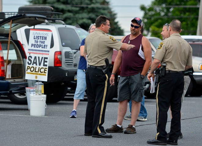 Northern York County Regional Police Chief Mark Bentzel, left, talks with residents prior to a North Codorus Township supervisors meeting, Tuesday, June 18, 2019.John A. Pavoncello photo