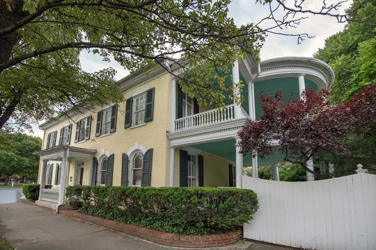 The Himes Mansion, located on the Square in New Oxford, is surrounded by gardens and a circular veranda. It was built in 1804 and originally served as a tavern.