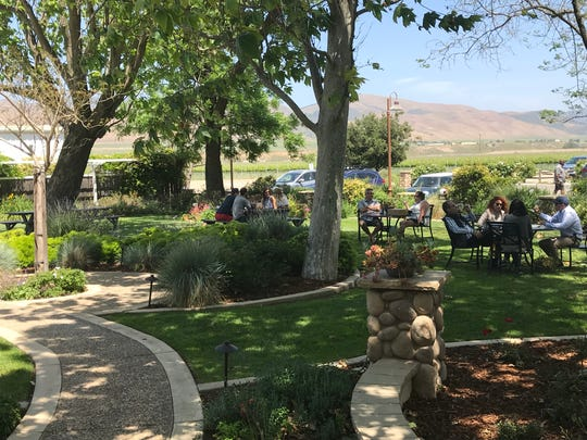 The tasting room of Riverbench Vineyard & Winery, in the Santa Maria Valley, Calif., wine country, features gardens with plentiful seating.
