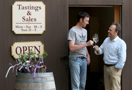 Oskar Bynke and Fred Merwarth, co-owners of Hermann J. Wiemer Vineyards, pose outside their Seneca Lake tasting room.  Bynke is co-chair of FLXcursion and Merwarth will be a panelist.