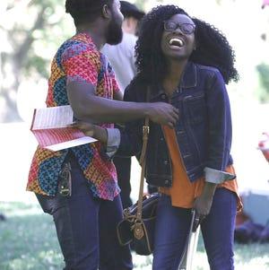Damilola Afolabi, left, shares a laugh with Ericka Jones at the Juneteenth celebration Wednesday, June 19, 2019, at Lake Redding Park.