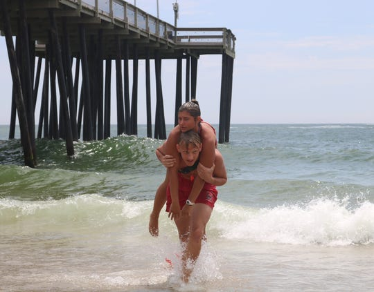 Ocean City Beach Patrol rookies participate in Passive Victim training where they must rescue an individual from the water who may be unconscious. The training took place on the beach by Jolly Rogers at the Pier on June 18, 2019.