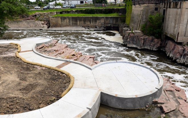 Lookout platforms are being implemented behind the bridge at Falls Park. The concrete base for the walk path is in place as of Wednesday, June 19.
