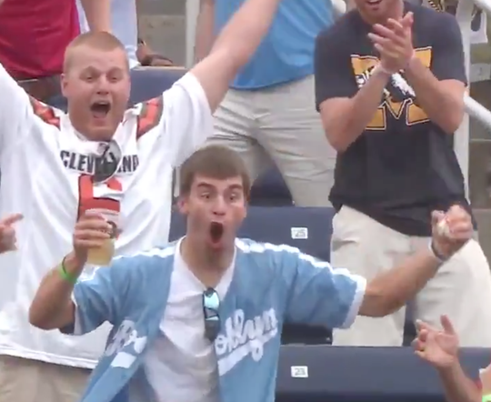 Austin Buysse, a former Dakota Wesleyan University quarterback and graduate, caught a home run ball at the College World Series Monday in Omaha, Nebraska. His catch was caught on video and went viral online.