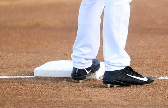 A player with the Sioux Falls Canaries stands on first base during a game against the Saint Paul Saints on Tuesday, June 18, at the Birdcage in Sioux Falls.