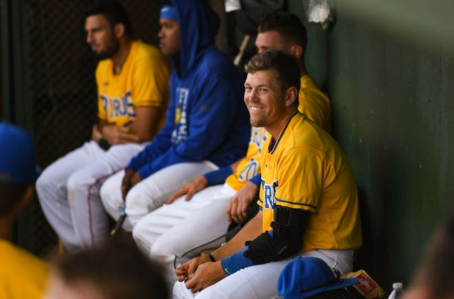 Andrew Ely smiles in the dugout Tuesday, June 18, at the Birdcage in Sioux Falls.