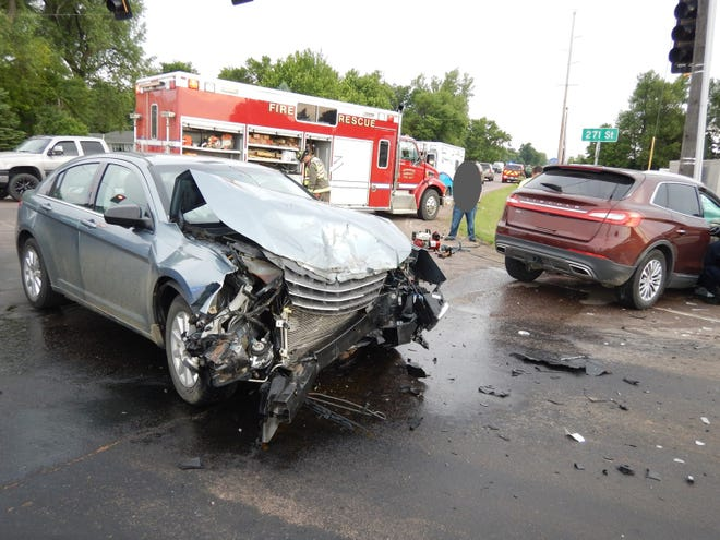 Responders arrive at the scene of the car accident at Cliff Avenue and 271st Street Wednesday morning.