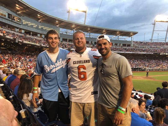 (left to right) Austin Buysse, Zach Nuy and Tyson Sonnenburg decided to take a spontaneous trip to watch the College World Series in Omaha, Nebraska on Monday. Buysse caught a home run ball that was caught on camera and has gone viral.