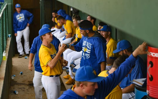 Sam Bragg and Luis Pollorena exchange a handshake in the dugout during the Canaries game against the Saint Paul Saints on Tuesday, June 18, at the Birdcage in Sioux Falls.