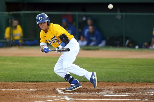 Andrew Ely attempts to bunt during the Canaries' game against the Saint Paul Saints on Tuesday, June 18, at the Birdcage in Sioux Falls.