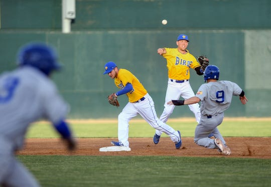 Jordan Ebert of the Sioux Falls Canaries ducks out of the way after beating Saint Paul Saints player Dan Motl to the base while Andrew Ely of the Canaries throws the ball to first during their game Tuesday, June 18, at the Birdcage in Sioux Falls.