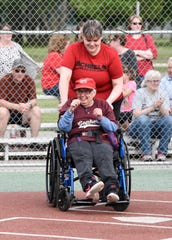 Lisa Seifert smiles after her hit in a Miracle League game featuring the Gophers vs. the Huskies, Tuesday, June 18 at Whitney Park. Every batter gets to hit once each inning and rounds the bases to score every inning.