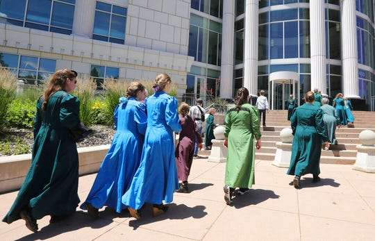 People arrive at the Matheson Courthouse Tuesday, June 18, 2019, in Salt Lake City. Members of a community on the Utah-Arizona border that is home to Warren Jeffs' polygamous sect are expected to raise concerns with a judge about favoritism and a lack of transparency by a board that oversees a former church trust that manages evictions and resales of homes and properties in the sister cities of Hildale, Utah, and Colorado City, Arizona. (AP Photo/Rick Bowmer)