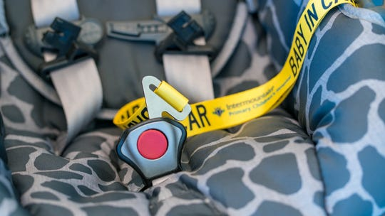 The safety snap is a low-tech device that connects to the snap in a five-point harness when the child is not in the car seat. When removed, the snap can be worn as a lanyard.