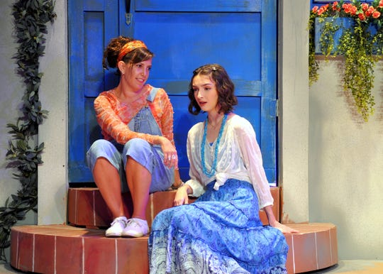 Donna Sheriden (Maggie Lynn Held) gives motherly advice to her daughter, Sophie (Haley Root), on the even of Sophie's wedding in  the Young Actors Theatre production of the musical Mamma Mia!
