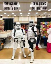 "Members of the 501st Legion ""Star Wars"" costume group greet guests at Infinity Con in Lake City."
