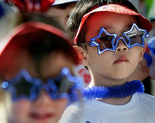 2012: Annsworth Academy's Ryan Chen  donned some cool shades during Tuesday's Fourth of July celebration and parade at the school.