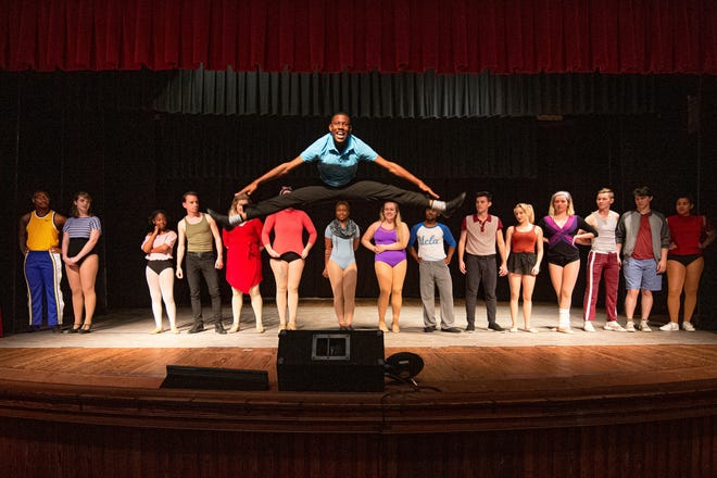 """Mike (Chazriq Clarke) proves he's as good a dancer as his sister when he sings """"I Can Do That!"""" in Monticello Opera House's production of """"A Chorus Line."""""""