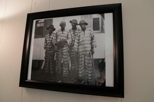 Photos from the state archives that represent the history of incarceration in Florida are displayed inside of Joseph House, a ministry to assist the formerly incarcerated, created by the Diocese of Pensacola-Tallahassee that recently opened in Tallahassee.