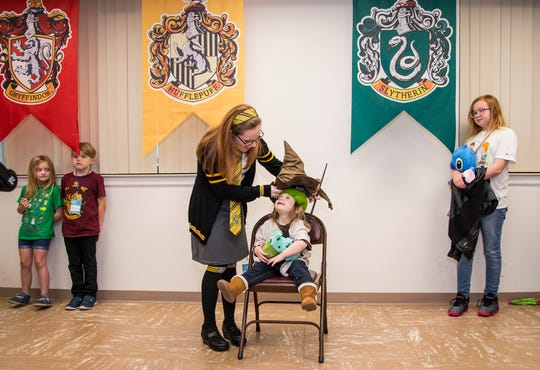 A young fan finds out which house she belongs in at a Harry Potter Sorting Hat  photo event at Infinity Con in Lake City.