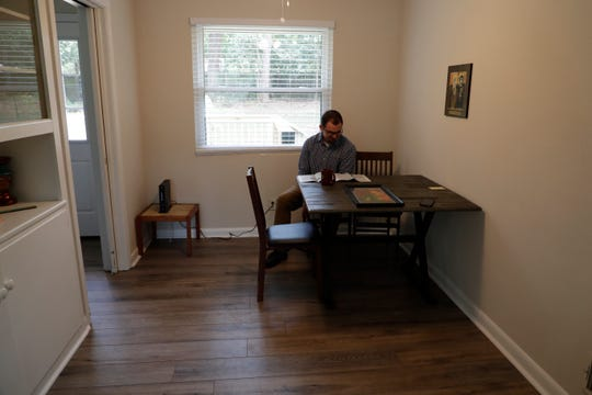 Intern Tyler Parker reads in the dining space at Joseph House, a ministry to assist the formerly incarcerated, created by the Diocese of Pensacola-Tallahassee that recently opened in Tallahassee.