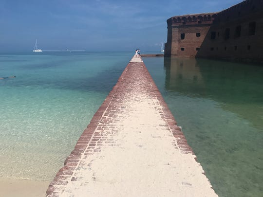 A moat wall surrounds Fort Jefferson at Dry Tortugas National Park.