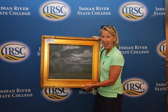 "Dr. Tina Hart won a framed ""Night Blooming Cereus"" giclée at the 2019 Alumni & Friends Golf Tournament, donated by landscape artist Rick Kelly.  Hart is vice president of Enrollment and Student Services at Indian River State College."