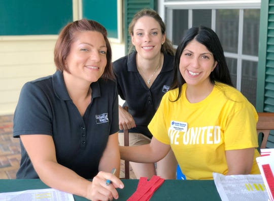 Melissa Ogonoski, left, and Caitlin Puppo, both of the United Way of Indian River County, with Valerie Esposito of Schlitt Services.