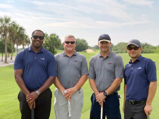 Don Lewis, John Willard, Loren Gaitlin and Bob Martellotti at the 2019 Citrus Golf Tournament for the United Way of Indian River County.