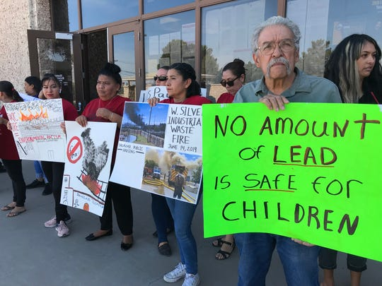Parents of Beall Elementary School students and members of the Familias Unidas del Chamizal protest the school's closure outside El Paso ISD's Education Center on June 18, 2019.