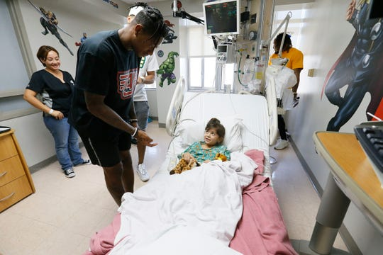 Baltimore Ravens safety DeShon Elliott visits Valentina Herrera at Las Palmas Medical Center on Wednesday, June 19, 2019, in El Paso. Former UTEP players Alvin and Aaron Jones were joined by several NFL players during the hospital visit and for the Jones Brothers Youth Football Skills Camp at Burges High School. The brothers played football at Burges and went on to play at UTEP.