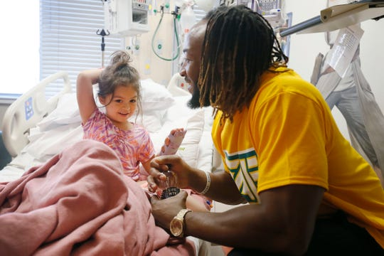 Former UTEP football player Aaron Jones visits Harmonii Sophia Hardin at Las Palmas Medical Center on Wednesday, June 19, 2019, in El Paso. He and his brother Alvin Jones visited young patients in the hospital along with other NFL players in town for the Jones Brothers Youth Football Skills Camp. The brothers played football at Burges High School and went on to play football at UTEP.