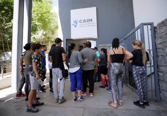 Cuban asylum seekers arrive at the Centro de Atencion Integral a Migrantes in Juarez. CAIM is processing asylum seekers an issuing numbers.