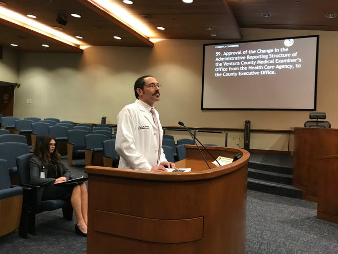 Dr. Christopher Young appeared last week before the Ventura County Board of Supervisors with a request to make the Medical Examiner's Office an independent unit. Seated behind him is Dr. Renee Higgins, chief operating officer of the office.