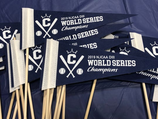 Mini pennants were handed out to celebrate the Dukes' national championship in baseball at Wednesday's parade.