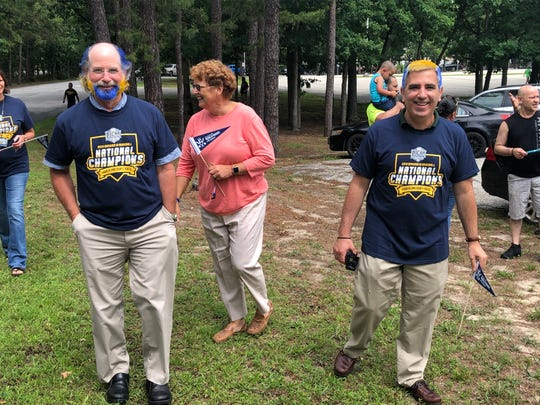 Cumberland County College staff members went as far as to paint their hair blue and yellow to celebrate the baseball team's national championship Wednesday.
