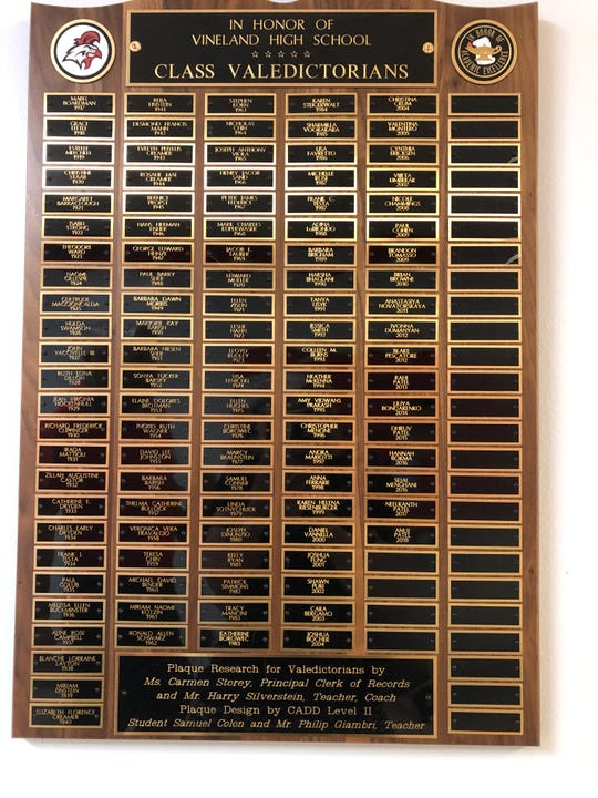 A plaque at Vineland High School 11-12 honors the VHS valedictorians dating back to 1917.