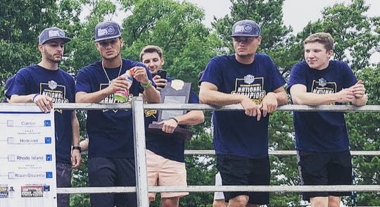Cumberland County College baseball players check out the crowd at Wednesday's national championship parade.