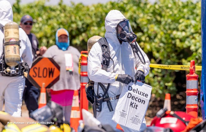 Multi-agency response to a pesticide contamination of more than 60 workers in a grape vineyard on Avenue 408 west of Road 56 and Dinuba on Tuesday, June 18, 2019.