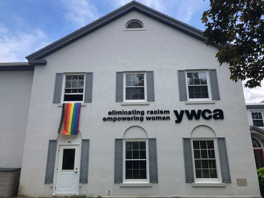 A rainbow Pride flag hangs from the window of the YWCA in downtown Wausau on June 19.