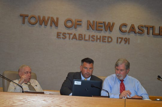 New Castle Assessor Josh Herman, left, confers with Board of Assessment Review Chairman Howard Dubs on June 18.