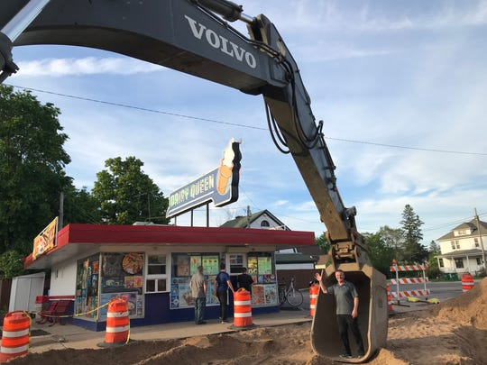Patrick Anhalt, the owner of Dairy Queen in Wisconsin Rapids, stands in construction equipment in front of his business on East Grand Avenue.