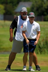 Quanah's JT Boyd studies his tee shot with the help of his father and caddy, Trenton, Tuesday afternoon during the Texas-Oklahoma Junior Golf Tournament at The Champions Course at Weeks Park.