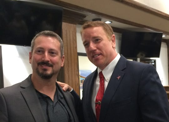 State Sen. Pat Fallon poses for a photo with a town hall attendee Wednesday in Wichita Falls.